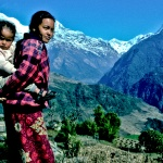 Young Tibetin mother with children overlooking Annupurna Himayala Range