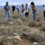 ARCHAEOLOGISTS SURVEY THE GROUND ON THE KANE RANCH ON THE ARIZONA STRIP