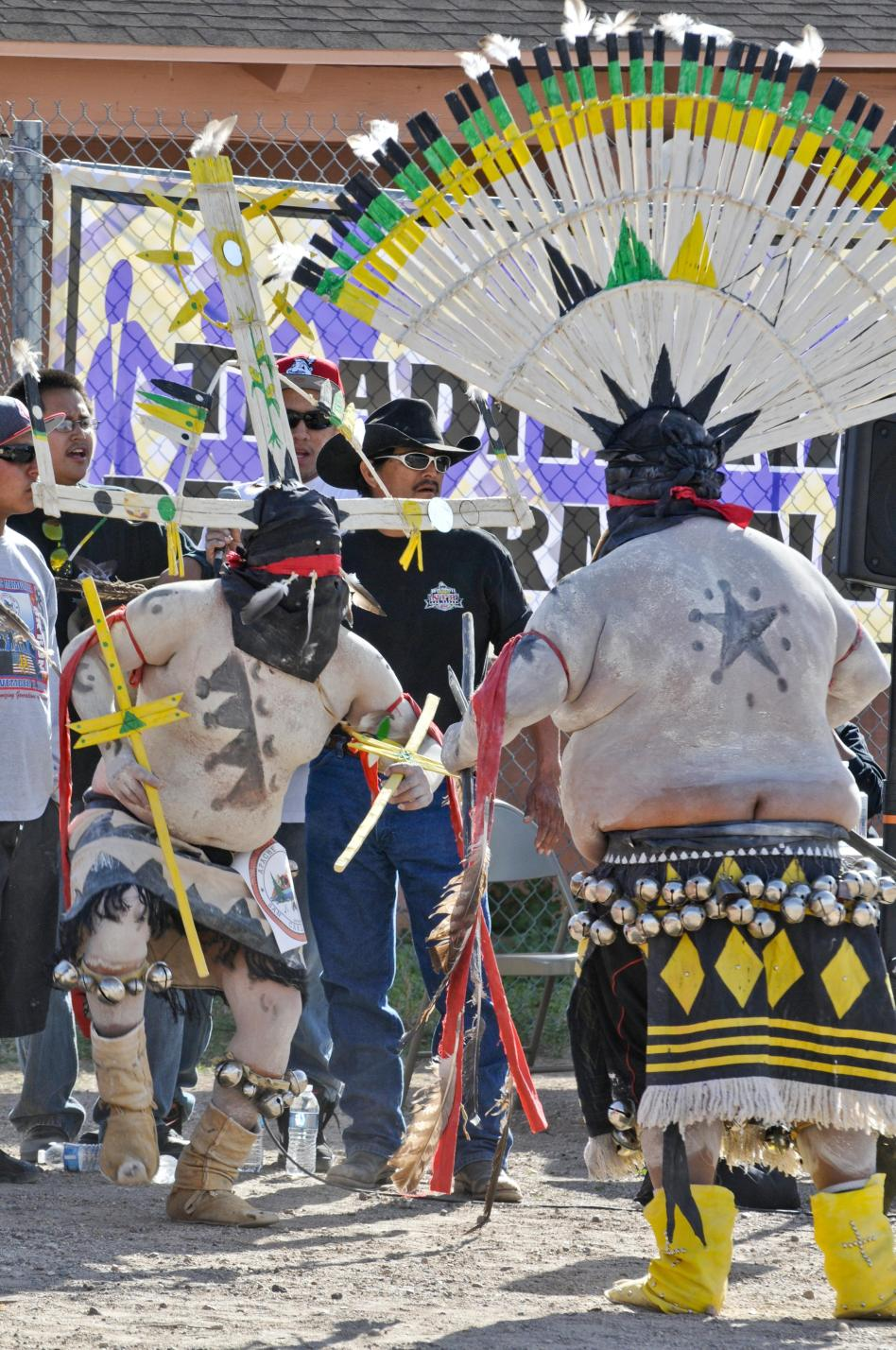 The San Carlos Apache Crown Dancers paint during the daylight and makes them more popular than the White Mountain Apache Crown Dancers who only paint the girl at night.