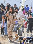 The Apache Clown from the San Carlos Crown Dancers takes a Tohono prisoner for a dance