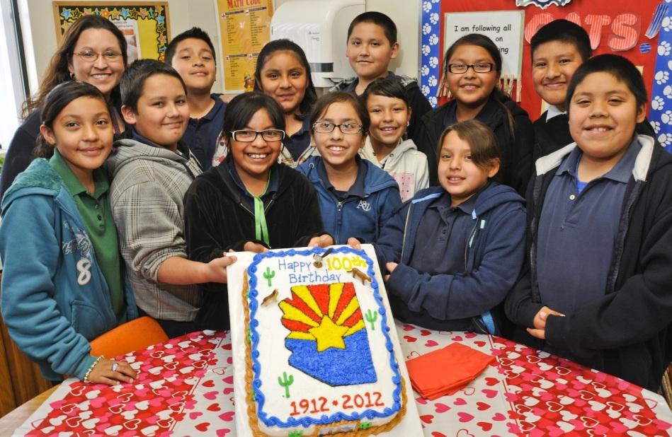 POSING WITH ARIZONA 100 YEARS OF STATE HOOD BIRTHDAY CAKE