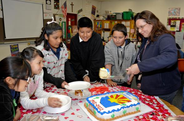 Tohono Students line up for their piece of the 100 years cake.