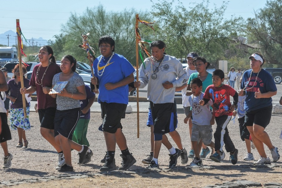 THE TOHONO O'ODHAM SPIRIT RUNNERS FINISH THEIR PILGRIMAGE FOR KATERI TEKAKWITHA CARRYING HER CROSS TO HER CANONIZATION