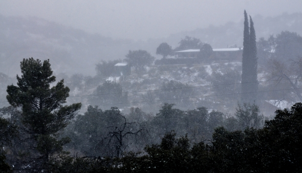 CATALINA HIGHWAY THROUGH ORACLE ROAD IN SNOW FLURRIES