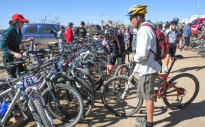 RIDERS STACK THEIR BIKES  CLOSE TO THE START