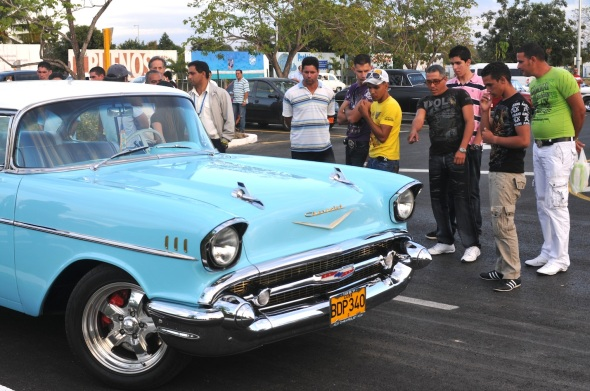 This cherry chevy was parked in front of the Havana InterNational Airport and was attracting big crowds,