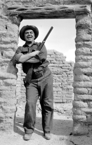 "Ernest Borgnine yucks it up during the 1958 filming of ""The Badlanders"" at Old Tucson. The movie dealt with two men being released from the Arizona Territorial Prison at Yuma in 1898. Both want gold and revenge from a small mining town who imprisoned them unjustly."