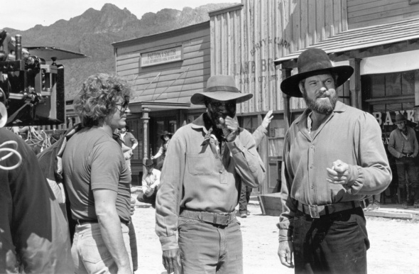 "Michael Landon, left, sets up a scene with Moses Gunn, center, and Merlin Olsen, right, during the filming of an episode of ""Father Murphy"" at Old Tucson."