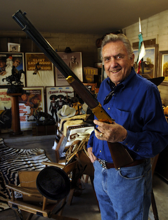 Robert Shelton holds a Winchester Centennial 30-30 rifle given to him by his former partner and friend John Wayne.