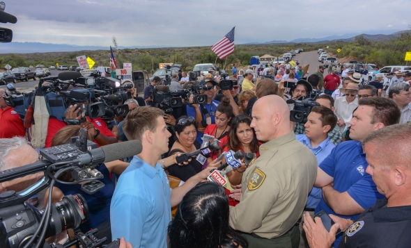 Pinal Sheriff Paul Babeu answers questions telling the press he is there to protect everyone rights