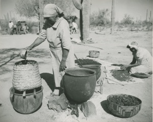 Papago cooks work over baskets and ollas for cooking 1930's. Today the Papago Tribe is known as the Tohono Oodham or Desert People.