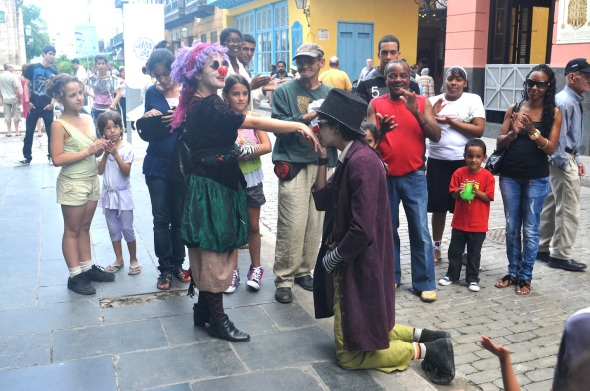 STREET MIMES PERFORM TO THE PLEASURE OF LOCALS WHO TIP THE ACTORS WITH PESOS