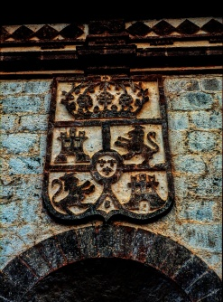 Spanish Royal Crest above the doorway