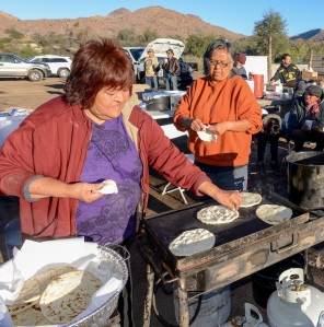For breakfast Vonda Cassadore (left) and her friend, Kris Salaloa, work together to fry bread and tortillas for the hungry, growing camp of protestors.