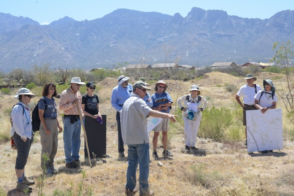 Henry Wallace shows a tour of the Honey Bee Preserve the ballcourt.