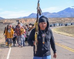 Nosie Sr leads his people from San Carlos Arizona homeland of the San Carlos Apache to Oak Flat, Apache Holy Ground threatened by the Resolution Mine. The Canadian mining company wants to collapse the Apache's sacred mountain and to have robots mine the ore at great depths to deep and hot for humans to work without moon suits.