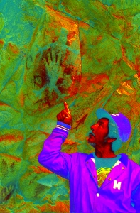 Filtered photograph of Lizard now only shows a hand print which was made by an artist filling his mouth with paint and blowing it through a reed toward his hand on the rock.