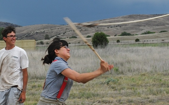 VICTORIA BOWLER shows ALEXANDAR BALLESTEROS how to throw ATLATL darts