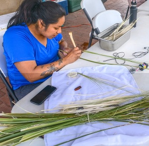 Marcy Pablo, a Tohono O'odham from Topawa prepares basket weaves for their