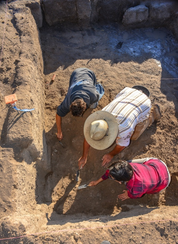 Archaeologist Will Russell from ASU works with Alexander Ballesteros and Alisha Stalley to get the knack of working with a trowel in an archaeological dig.