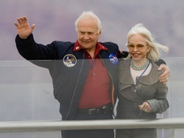Former astronaut Buzz Aldrin and his wife Lois, waves to the crowd after making the ceremonial first walk Tuesday afternoon, March, 20, 2007, on the glass-bottomed Grand Canyon Skywalk located at Grand Canyon West's Eagle Point in Arizona. Indian leaders, former astronauts and other visitors stepped gingerly beyond the Grand Canyon's rim Tuesday, staring through a glass floor and into the 4,000-foot chasm below during the opening ceremony for a new observation deck. (AP Photo/The Arizona Republic, Rob Schumacher) ** MARICOPA COUNTY OUT, MESA TRIBUNE OUT, MAGS OUT, NO SALES **