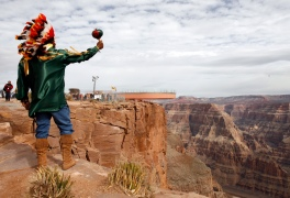 Don Havatone, of the Hualapai tribe, watches the rollout of the Skywalk on the Hualapai Indian Reservation at Grand Canyon West, Ariz., Wednesday, March 7, 2007. The tribe will open it to the public later this month, charging $25 per person in addition to other entry fees. Organizers expect the Skywalk to become the main draw in a community of tribal attractions that includes a cowboy town, an Indian village, helicopter tours and Hummer rides through the outback. (AP Photo/Ross D. Franklin)