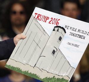 U.S. Republican presidential candidate Donald Trump holds a sign supporting his plan to build a wall between the United States and Mexico that he borrowed from a member of the audience at his campaign rally in Fayetteville, North Carolina March 9, 2016. Trump was interrupted repeatedly by demonstrators during his rally. U.S. Republican presidential candidate Donald Trump holds a sign supporting his plan to build a wall between the United States and Mexico that he borrowed from the audience at a campaign rally in Fayetteville North Carolina REUTERS/Jonathan Drake